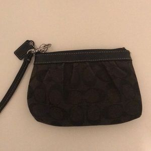 Black cloth Coach wristlet